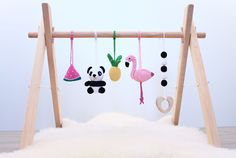 Flamingo and Panda baby play gym. Tropical nursery. Flamingo, Pineapple, Panda, Adventure. Activity baby center, pink, black and white, wooden frame, crochet baby gym toys by LanaCrocheting on Etsy https://www.etsy.com/listing/519700934/tropical-baby-play-gym-flamingo