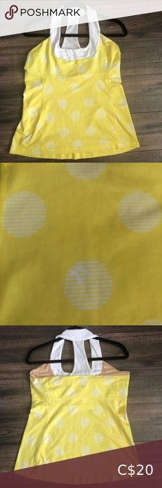 LuluLemon Yellow Workout Tank Top Cute workout tank with fun polka dot design No cups in built in bra (can be purchased at lulu) Gently used with no flaws lululemon athletica Tops Tank Tops