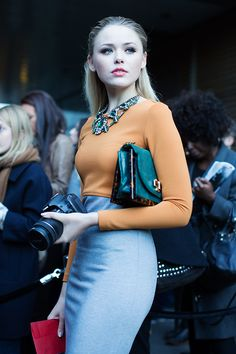 Street style gives an update the classic pencil skirt and sweater combo. The jeweled bib looks gorgeous here used as a focal point for the outfit.