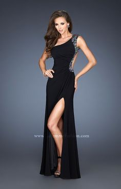 Super sexy one shoulder jersey gown with a high front slit and open back. The beading detail is stunning as it outlines the shoulder, back strap and skirt.