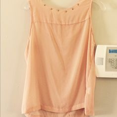 Light Peach/Pink Sheer Tank with Gold Dots Studs Light Peach/Pink Sheer Tank with Gold Dots all over and Gold Studs around neck line. Gold zipper in back. Size large. BEAUTIFUL!!! Perfect for fall with skinny jeans, flats, and cardigan. I wore a nude spaghetti strap shirt underneath. :-) Perfect for summer with jeans and flats! I LOVE this top. Just making room for something new, or new to me. ;-) Tops Tank Tops