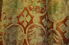 Details of Roundals on tunic of the Göss Vestments.  The tunic is worken on a linen ground with coloured silk thread (blue,yellow, green, rust light brown, white, red).  It is worked in a variety of stitches, including brick stitch, what appears to be a form of counted stem stitch and long-armed cross stitch.