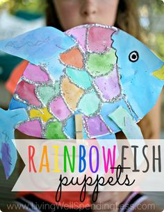 Looking for a fun  easy kids art project that doesn't require a whole lot of artistic ability?  These adorable rainbow fish look impressive but are easy enough for even the youngest artists to make on their own.  Turn them into simple puppets for hours of imaginative fun!