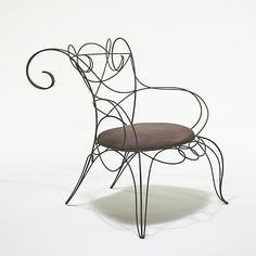 Lot 466: André Dubreuil. Ram chair. c. 1985, steel, leather. 28 w x 36 d x 35 h in. result: $12,000. estimate: $7,000–9,000. Provenance: Themes & Variations, LondonPrivate collection