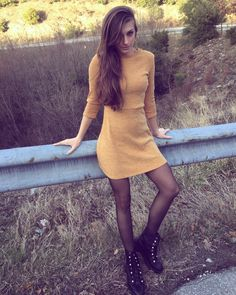Yellow dress black stockings, army boots with pearls