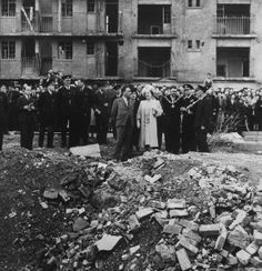 Queen Elizabeth and King George VI of Great Britain stop at Vallence Road, Stepney, in the East End, London, to examine the debris following and air raid, October 4, 1945
