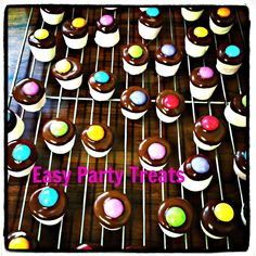 Easy Party Treats- marschmellow dipped in dark chocolate & topped with a smarty.