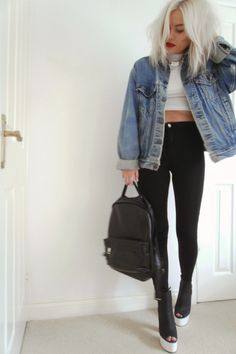 White crop tops, black high waisted pants, and denim jackets. Cute transitional outfit from winter to spring.
