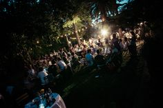 Garden wedding reception in Maremma, Tuscany, romantic string lights for evening wedding reception