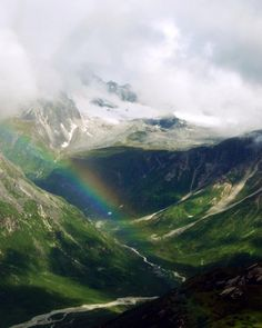 big rainbow in mountains