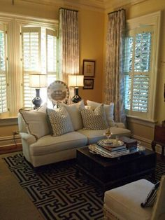 curtains above a bank of windows with plantation shutters window room
