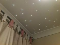 12 constellation projects products and pretties for your home a scattering of fiber optic lights gives the illusion of a sky filled with twinkling stars on a baby nursery room ceiling aloadofball Image collections
