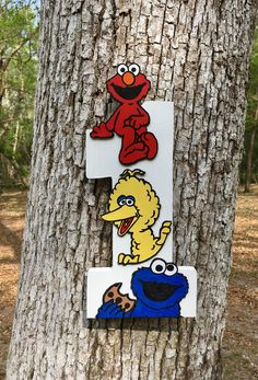 Sesame Street Hand Painted Centerpieces - Hand Cut Wood Numbers - Sesame Street Wood Cut Outs - Sesame Street Party by ChicDesignsByTiffany on Etsy https://www.etsy.com/listing/523246745/sesame-street-hand-painted-centerpieces