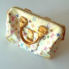 """LOUIS VUITTON WHITE MONOGRAM 30 handbag Item Specifics & Details: Retailed for $3,150. Bold and energetic Louis Vuitton """"Monogram Multicolore Speedy 30"""" satchel bag in white and camel tan coated canvas and leather. This coveted piece features 33 silk-screened colors designed by Takashi Murakami in 2003. Dual rolled top handles can be handheld or slung over the forearm. Top zip closure and pushlock zipper pull for easy access and security. Flap Measurements*: Handle Length: 11.5"""" Handle Drop…"""