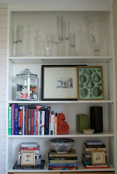 Bookshelves -- great idea to out matches in old glass chip jar