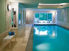 The walk-out basement in this home by Cunningham | Quill Architects features a luxurious indoor swimming pool.
