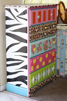 so colorful!  I painted my niece's dresser in pink and black zebra.  She adores it, and all of her friends are jealous! :D