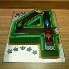 Birthday cake shaped as teh number four and made to look like a race track, this could be fun for Charlie's fourth birthday. Just need to add some Cars3 cars such as Lightning McQueen, Jackson Storm and Cruz Ramirez!