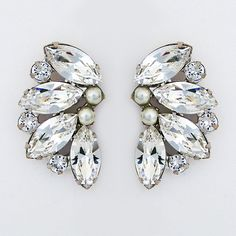 "Can we say ""Old Hollywood Glamour""? Large stud earrings featuring marquis crystals that reach beyond dazzling sparkle.  Designed by Debra Moreland for Paris. See more here: https://perfectdetails.com/Kiss-Me.htm"