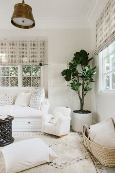 Home Decor and Lifestyle from Hello Lovely Studio: Erin Fetherston boho chic California farmhouse decor with mud cloth and Moroccan rug