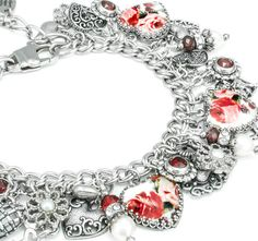 The wonderful red rose charm bracelet is created from a vintage china pattern c. 1948. Top this lovely piece off with fresh water pearls, ruby Swarovski crystals, ruby chatons in a heart setting and tons of heart charms and this lovely piece is sure to be a hit for any occasion. Enjoy my Charm Bracelet - Red Roses Bracelet - Heart Charm Bracelet - Red Rose Jewelry - Heart Rose Jewelry Heart Rose Jewelry.  Blackberry Designs Jewelry© Fine Jewelry Treasured for a Lifetime™  *Created with…
