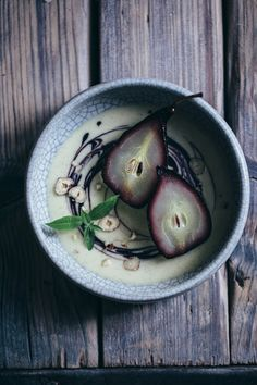 poached pears in elderberry juice with homemade vanilla sauce