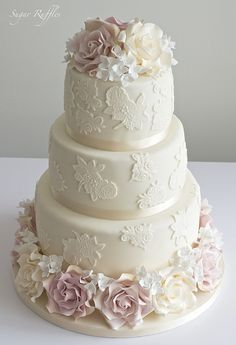 Lace Wedding cake with hydrangea flowers, amnesia and ivory roses