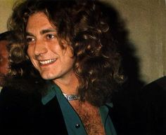 Robert Plant...the world's most perfect smile <3