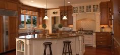 LOVE...two tone kitchen white and brown mixed cabinets and island...LOVE!  Google Image Result for http://codyausmus.files.wordpress.com/2012/06/9.jpg
