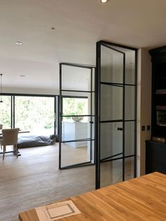 The metal framed doors can balance all sorts of interior decors. They look similar to the steel doors, but with their own benefits. Interior Double French Doors, Black Interior Doors, Door Design Interior, Aluminium Glass Door, Aluminium Sliding Doors, Sliding Glass Door, Door Dividers, Room Divider Doors, Kitchen Glass Doors