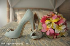 Wedding shoes and gorgeous bouquet #weddingshoes, #weddingbouquet, #plumeriabouquet Photo by Tad Craig Photography