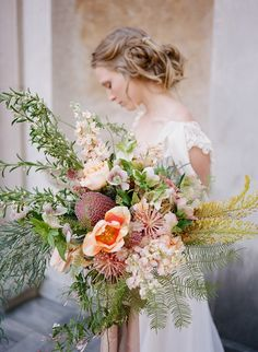 wild wedding bouquet with greenery and pink tones