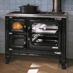 The Deva 100 cook stove ushers in a new era in wood-fired cook stoves. From its durable enameled cast iron surfaces as well as the nickel and chrome details to its ceramic glass cook surface and user friendly controls, it is a wood cook stove for your family, today.