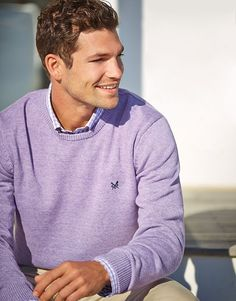 Crafted from 100% cotton with subtle flecked yarns, this lightweight knit is a casual classic.