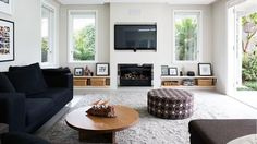 IOT0115HBELL_08 lounge room ottoman fireplace  wall tv