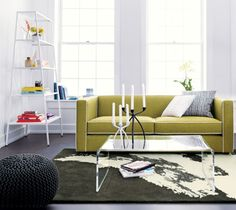 peekaboo clear coffee table  | CB2;  need a longer/bigger one from your custom guy, but it might help offset some of the heaviness with all the other furniture