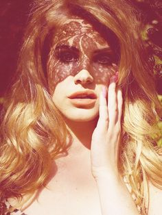 this is Lana del Rey off of someones tumbler and i like it because of the shadow over her face the photoagrapher is unknown and its from someones tumbler called http://breakfastatyurmans.tumblr.com