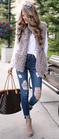fall outfit inspiration / vest + white top + bag + ripped jeans + boots