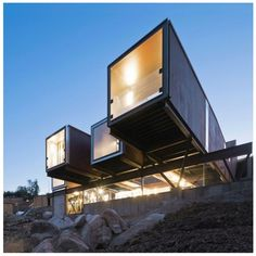 This shipping container home is truly a beautiful combination of traditional and modern. Caterpillar House is located on a hillside just outside...