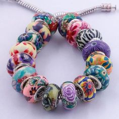 *Colorful & Vibrant Polymer Clay Assorted Euro Beads  . Starting at $5 on Tophatter.com!