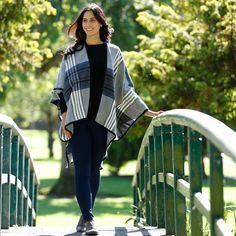 Blue tartan and grey cape paired with black knit jumper and jeggings, a great casual look for AW15
