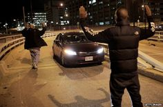 Protesters block a car in Washington DC, 3 December