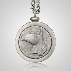 The Horse Pet Memory Charm is beautifully crafted from genuine pewter and features a horse. The charm suspends from an adjustable chain that features a sweet heart accent. This memory charm holds ashes, hair, earth, or any other small memento from life's most precious moments. These charms have been used to accent urns, as holiday ornaments, or even as car charms.