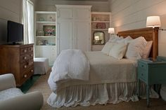Charming Home Tour ~ Florida Beach Cottage with white bedroom and wood accents. Note the floor is painted aqua.