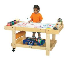 The Creative Caddie with side bins is an Art table that lets kids store supplies and create projects on a large table top. The creative caddie is mobile, easy to clean with its Write-n-Wipe adjustable