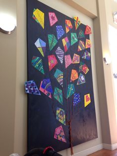 Cool idea for kids craft in a room ( playroom).  Kites can be made weekly and Added and even friends can help.