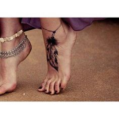 feather foot tattoo..my kind of thing :D