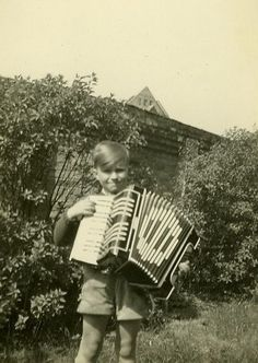 This is an exceptionally adorable picture. Maybe someday I will take an awesome picture of my child with an accordion.