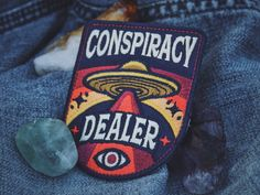 Conspiracy Dealer Patch - Metaphysical Fashion Accessory - Iron On Embroidered Patch - Aliens, UFO, Conspiracies, Esoteric, Truther Badge Pin And Patches, Iron On Patches, Travel Patches, Jacket Patches, Iron On Embroidered Patches, Embroidery Patches, Patch Design, Badge Design, Character Aesthetic