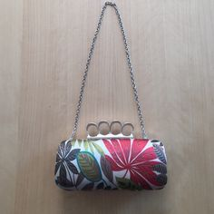 """Floral print """"brass knuckle"""" purse Edgy little purse you can use with the strap or tuck it into the purse (not removable). Bags Clutches & Wristlets"""